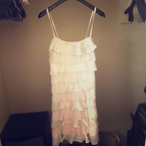 Beautiful white mini dress with adjustable straps!
